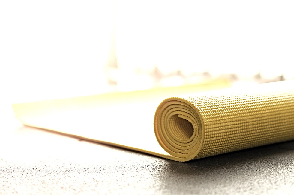 Yellow%20yoga%20mat%20on%20rubber%20floo