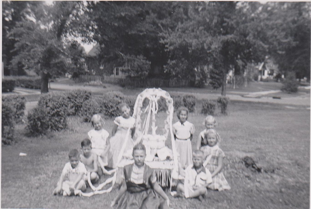 Children gathered around their float in Clokey Park, at corner of 20th & East Main, 1950s.