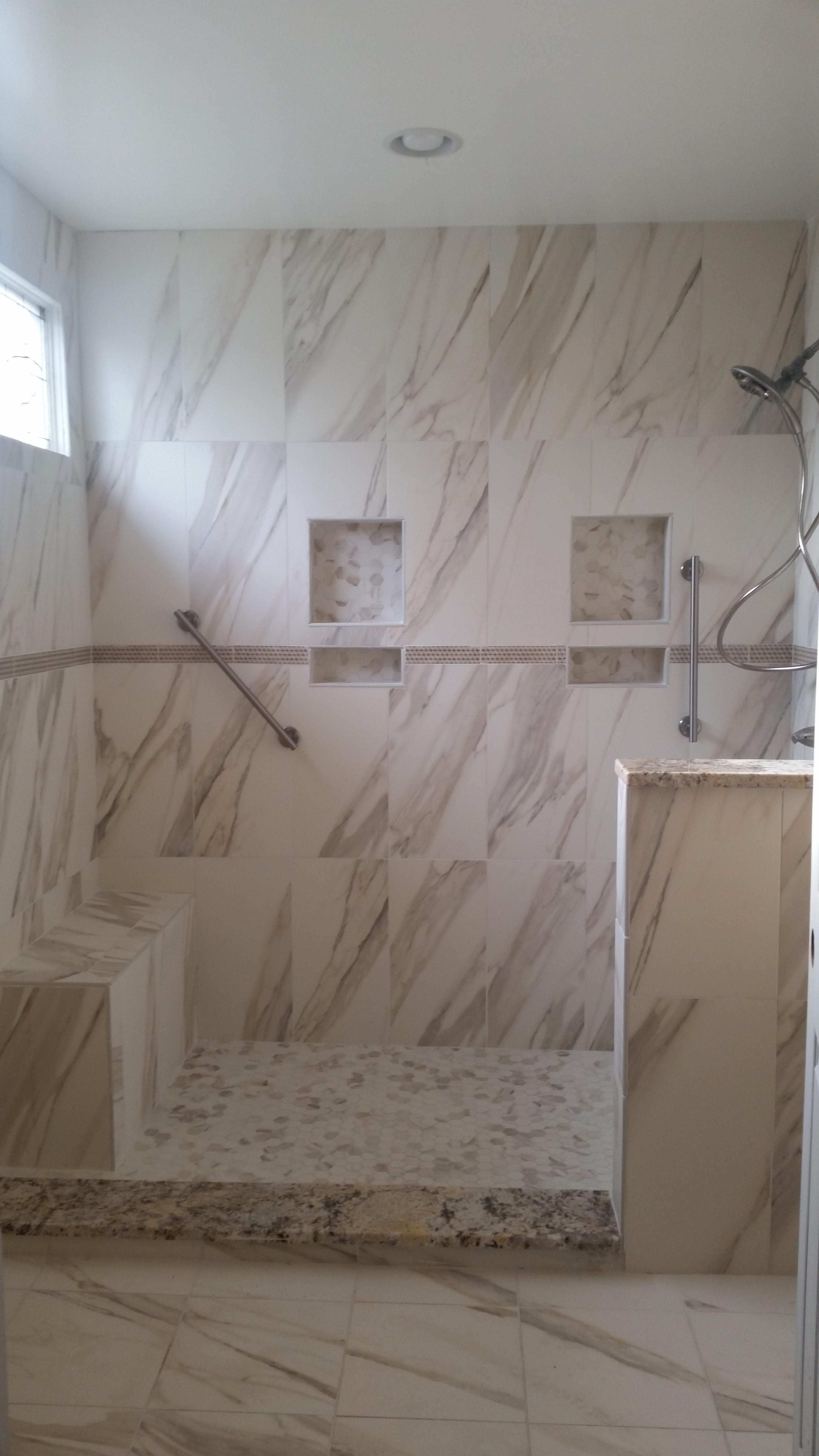 Marble look tile walk-in shower