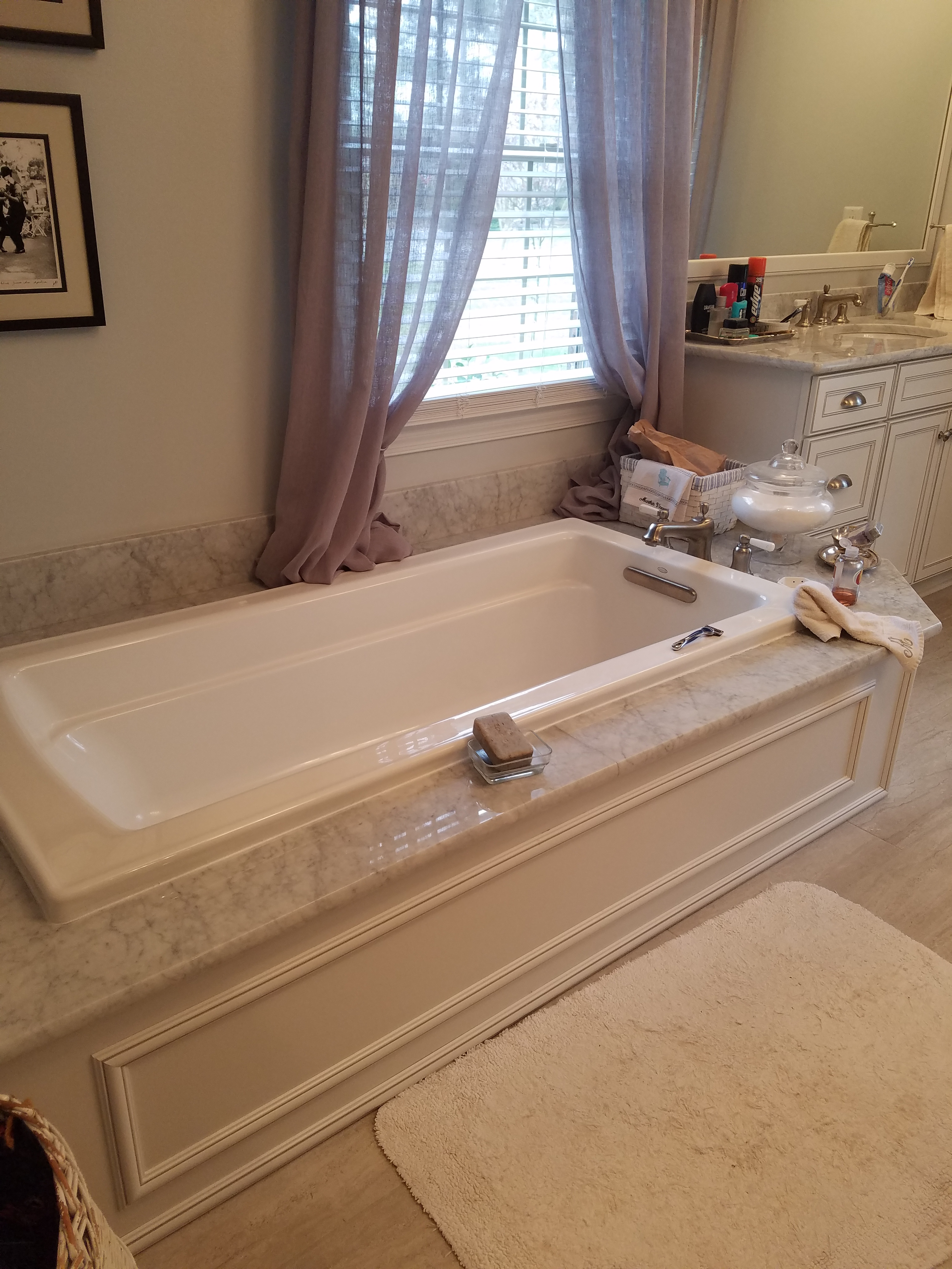 Wood paneled tub deck, carrara white