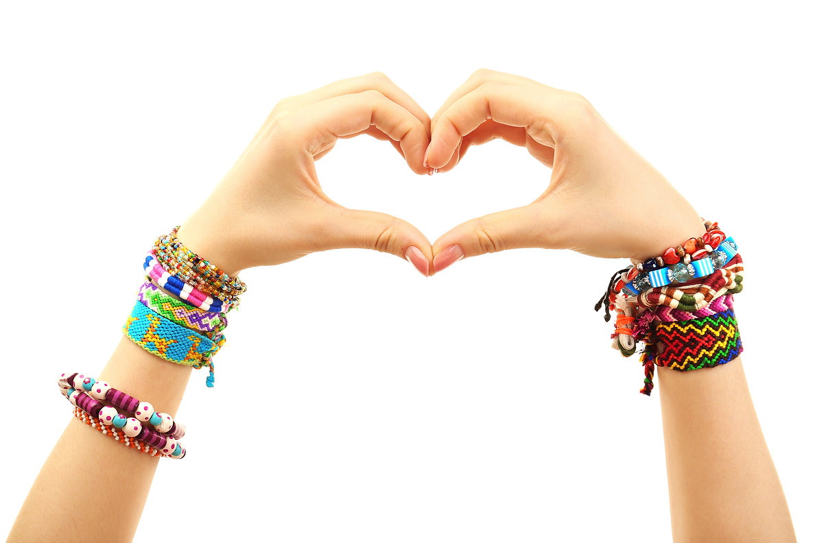 Female hands in shape of heart with brac