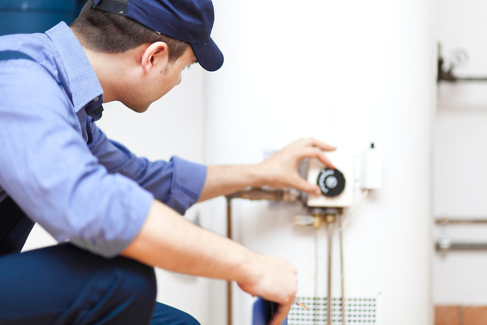 Plumber checking waterheater