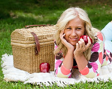 Woman eating a apple at Picnic.jpg