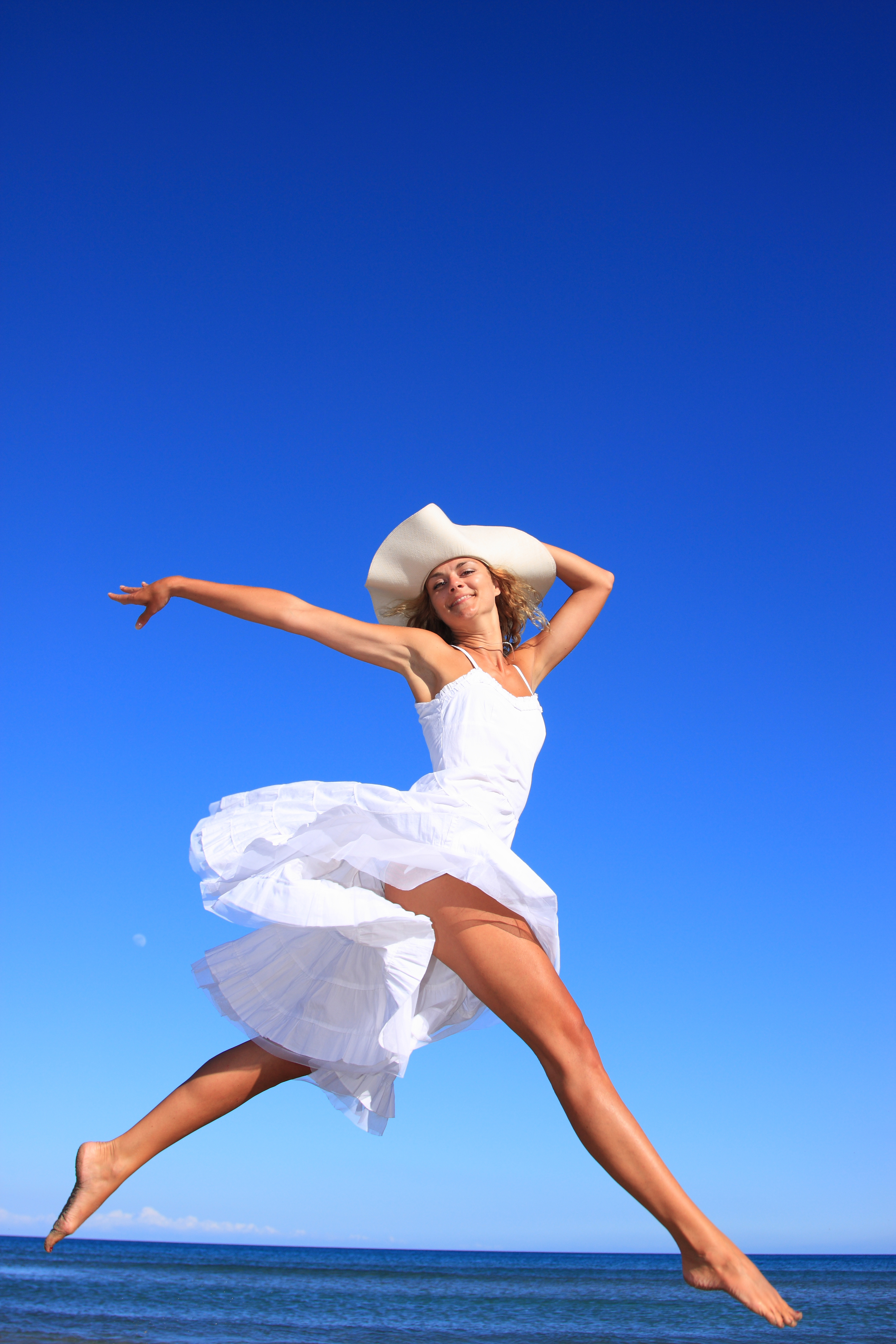 Woman Running in White Dress.jpg