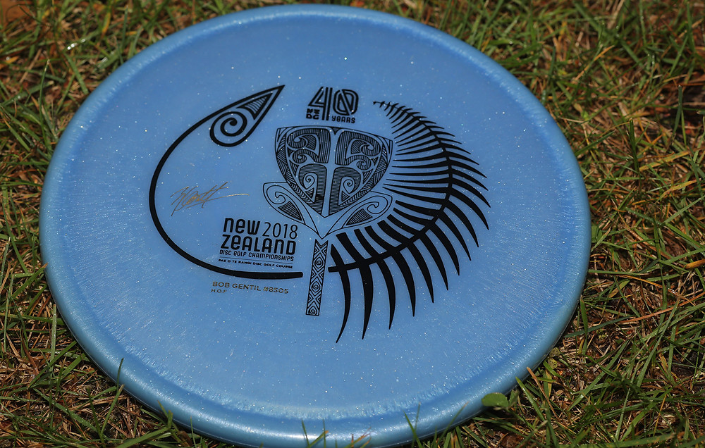 40 Years of NZDG: Our buddy Bob's signature stamp on a blue metal-flake Cosmic Kea