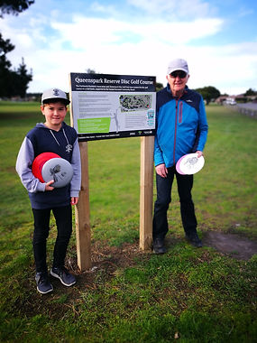 Grandson and Grandfather playing disc golf at Queenspark Reserve Disc Golf Course