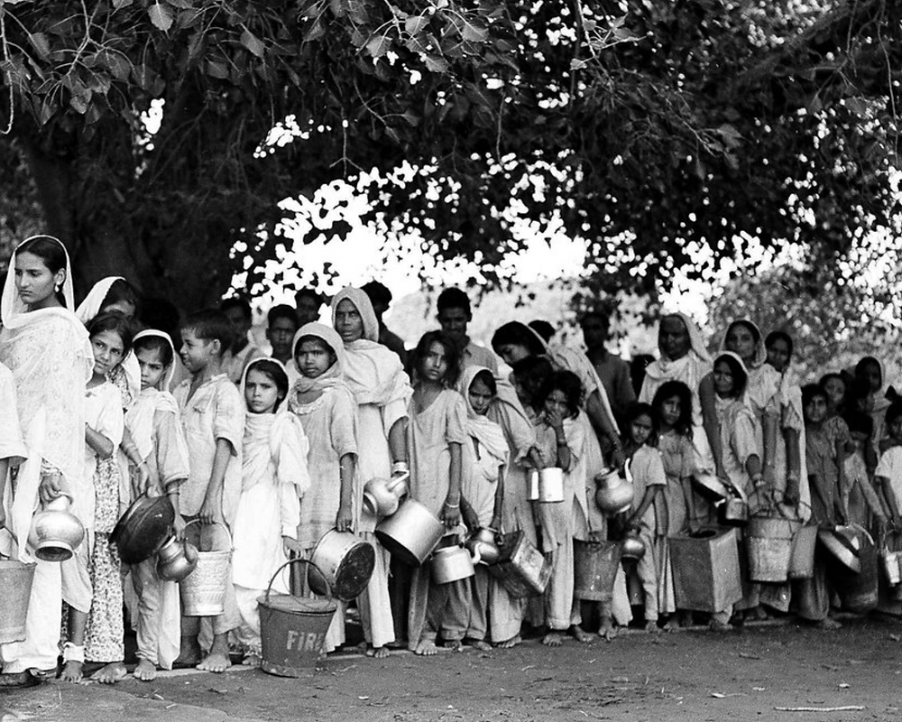 Muslim refugees, evacuated from areas of unrest in New Delhi, queue up for water at New Delhi's Old Fort in September 1947. Max Desfor/AP