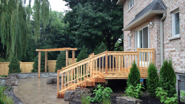 Complete back yard landscape including cedar deck, cedar pergola, patio, gardens, walkway.