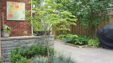 Landscape Back Yard with Natural Stone patio, retaining wall and plants