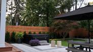 Interlocking Stone Patio for dining along cedar deck.