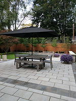 Paver stone patio with dining and entertaining space.