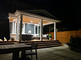 Outdoor Living Space for evening relaxation, including raised deck, patio and dining areas.