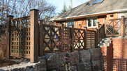 Unique Wood & Glass Railings on retaining wall
