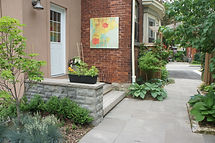 Back yard entrance, patio, gardens, steps and retaining wall