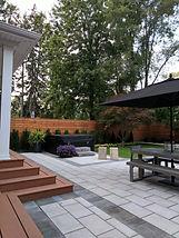 Stone Patio, cedar deck, hot tub, cedar fence, gardens.
