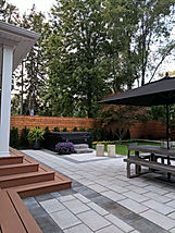 Stone Patio, cedar deck, hot tub, cedar fence, gardens.
