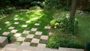 Back yard patio and unique lawn stepping stones
