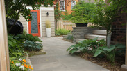 Cozy back yard.  Natural stone patio, custom shed, retaining wall and steps