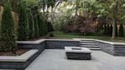 ModPatio with retaining walls, stone steps and natural gas firepit.