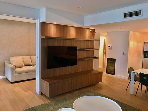 One of our most recent renovations complete with this stunning custom builtin entertainment unit.jpg
