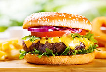 hamburger with fries on wooden table.jpg