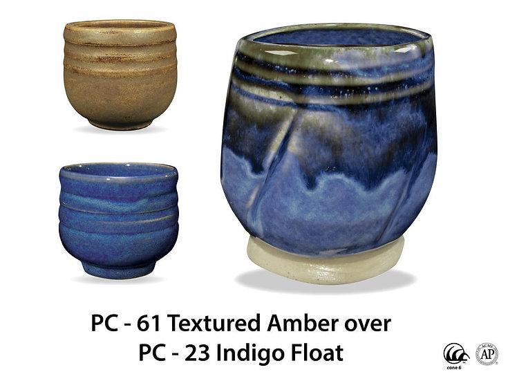 PC-61 Textured Amber OVER PC-23 Indigo Float Glazes