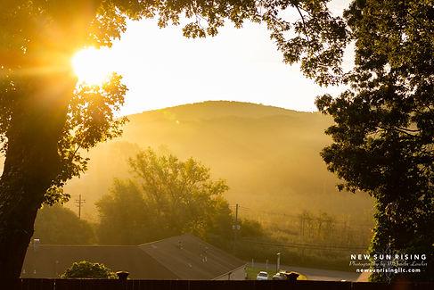 Image of a sunrise over a mountain.