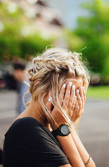 person covering face with hands outdoors_edited.jpg
