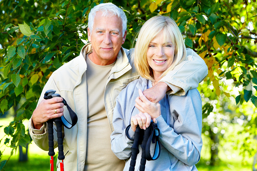 bigstock-Happy-senior-couple-hiking-in--36426796