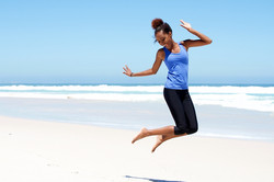 bigstock-Sporty-Woman-Jumping-At-The-Be-125298926