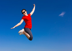 bigstock-Teenage-girl-jumping-running--89771855