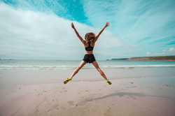 bigstock-Young-Woman-Doing-Star-Jumps-O-66478531
