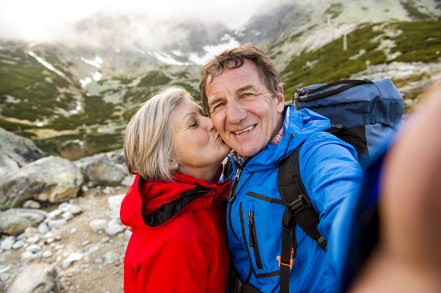 bigstock-Senior-couple-hiking-67175812