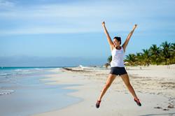 bigstock-Female-Athlete-Jumping-At-Beac-84410438