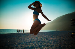 bigstock-Woman-jumping-in-the-air-on-tr-95627954