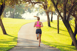 bigstock-Attractive-young-woman-jogging-59727998
