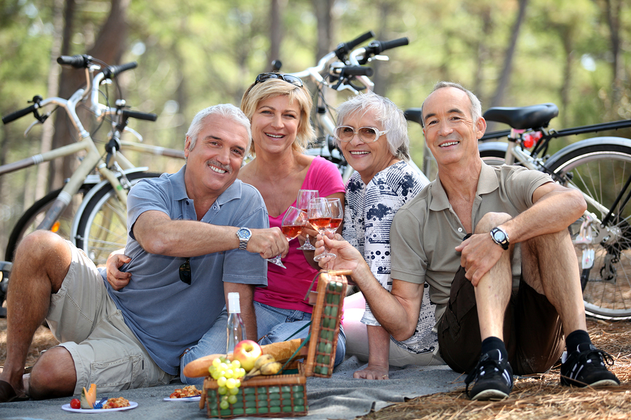 bigstock-Two-older-couples-enjoying-a-p-25833881