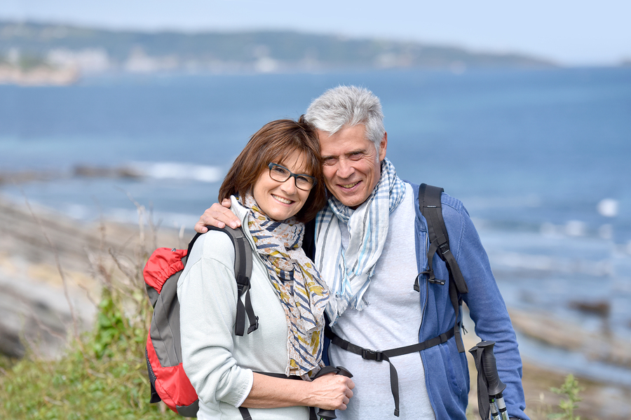 bigstock-Smiling-senior-hiking-couple-s-132662222