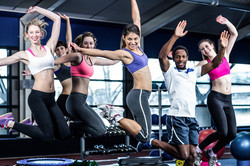 bigstock-Fit-group-smiling-and-jumping--114949310