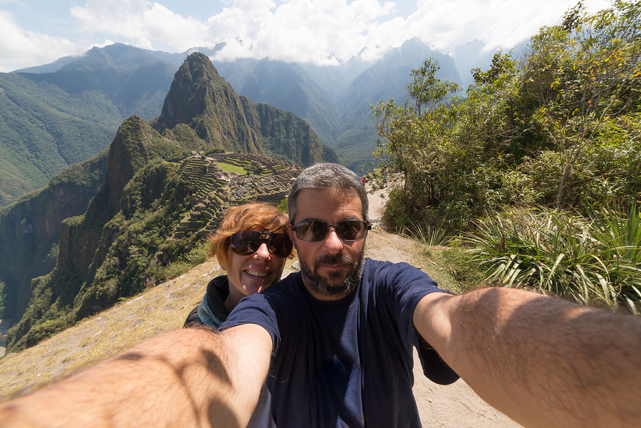 bigstock-Couple-Taking-Selfie-At-Machu--115198310