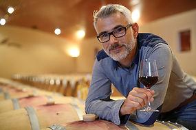bigstock-Winemaker-tasting-red-wine-in--