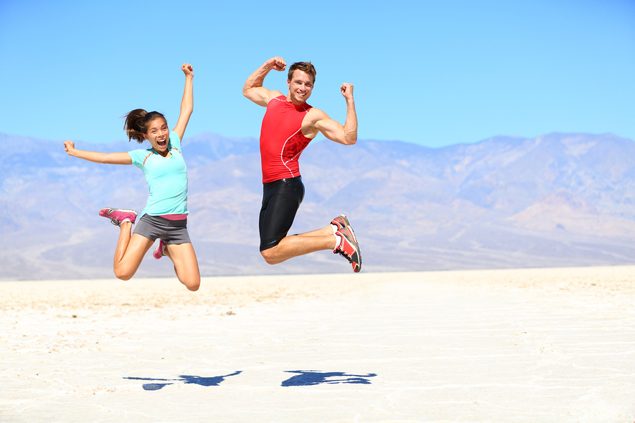 bigstock-Success-Young-runners-jumping-43000399