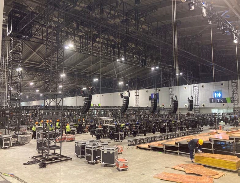 Five hangs of eight L-Acoustics Kara rigged up and spread across the stage area