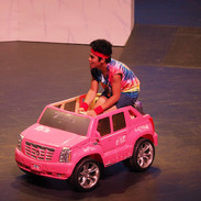 Sonny chases after Kira in a toy car he