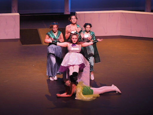 Melpomene, Calliope, and Sirens pose at