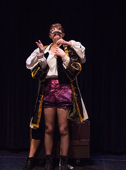 Captain Blackstache, after losin her hand, and Smee, attempting to help Stache applaud.