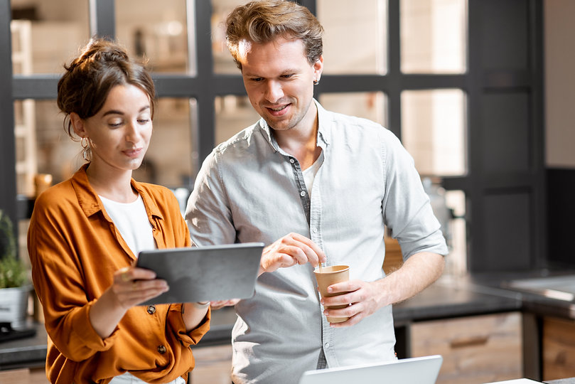 man-and-woman-managing-their-small-business-G36WUHJ.jpg