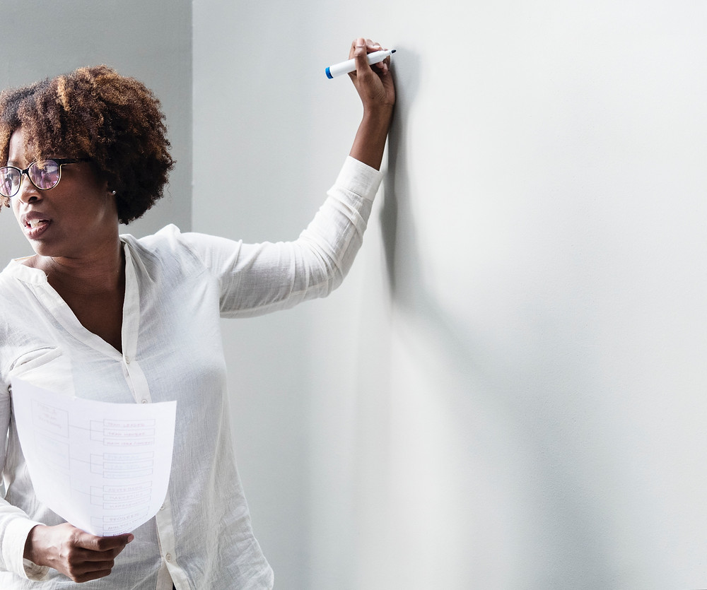 Teacher at a board