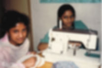 Lilu and Sister sewing at Saathi House in Birmingham in the 1980s.jpg