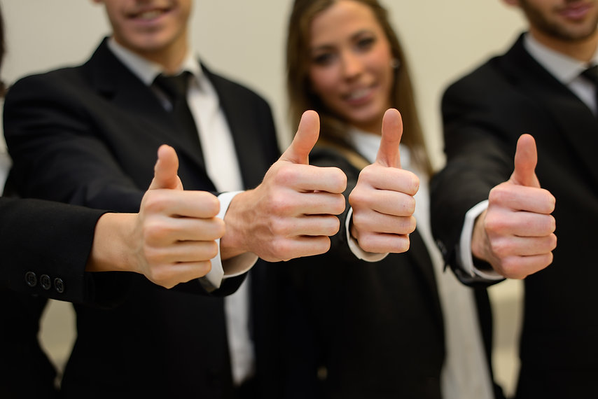 business-team-holding-their-thumbs-up-UR